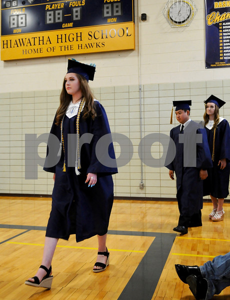 The forty six graduates of Hiawatha High School file into the gym for commencement ceremonies on Friday in Kirkland.  Steve Bittinger - For Shaw Media