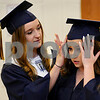 Lexi Norvell helps fellow Hiawatha High School graduate Lizzy Taylor secure her cap before commencement festivities. A class of forty six seniors graduated on Friday in Kirkland.  Steve Bittinger - For Shaw Media