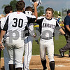 Sam Buckner for Shaw Media.<br /> Preston Havis high fives team mates after hitting a grand slam on Thursday May 25, 2017 against Fenton.