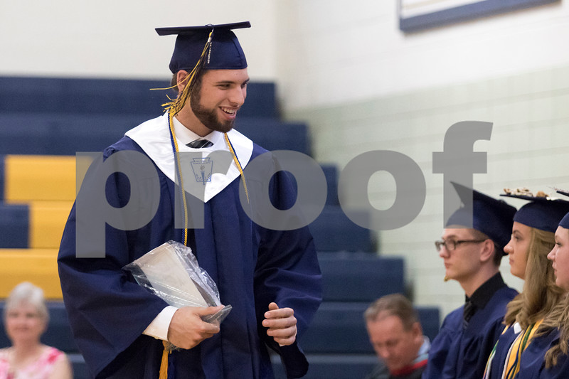 Sam Buckner for Shaw Media.<br /> Edwin Yockey walks back to his seat after recieving the Funderburg scholarship for a well rounded individual on Friday May 26, 2017 at Hiawatha High School.
