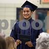 Sam Buckner for Shaw Media.<br /> Roberto Vasquez holds up his diploma on Friday May 26, 2017 at Hiawatha High School.