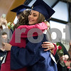 Sam Buckner for Shaw Media.<br /> Jessica Znamenski hugs her mom after giving her a flower in appreciation at graduation on Friday May 26, 2017.