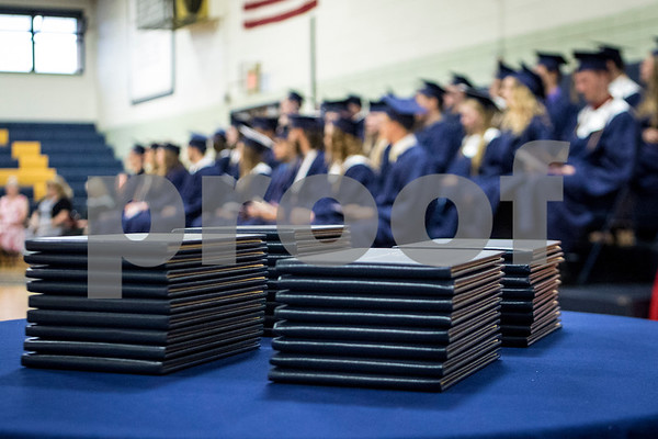 Sam Buckner for Shaw Media.<br /> Diplomas are stacked on a table during the Hiawatha graduation ceramony on Friday May 26, 2017. The Hiawatha 2017 graduating class had 37 members.