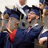 Sam Buckner for Shaw Media.<br /> Andrew Bonilla cheers along with his classmates after graduating on May 26, 2017 at Hiawatha High School.