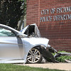 dc.0527.Car crash into PD