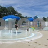 Children play in the baby pool Saturday at Hopkin's Park Pool in DeKalb.