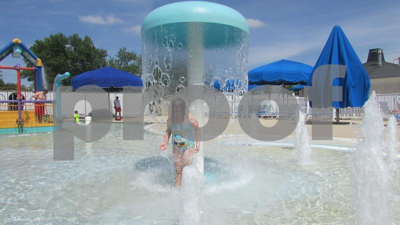 Alayna Kent, 8, of DeKalb plays in the baby pool Saturday at Hopkin's Park Pool in DeKalb.