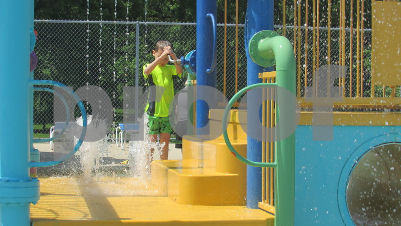 Arlo Shears, 6, of DeKalb plays in the baby pool Saturday at Hopkin's Park Pool in DeKalb.