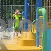 Arlo Shears, 6, of DeKalb plays in the baby pool Saturday at Hopkin's Park Pool in DeKalb.