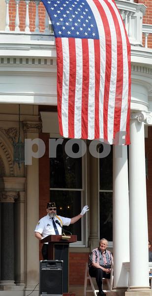 American Legion Post 66 Chaplain Robert McCann addresses a Memorial Day gathering at The Ellwood House Museum on Monday in DeKalb.  Steve Bittinger - For Shaw Media