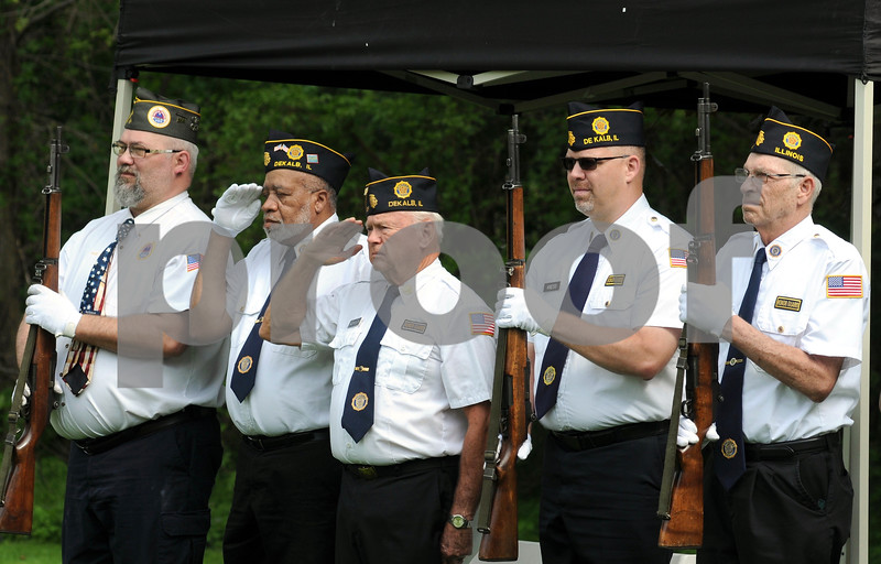 An honor guard salutes the flag at Memorial Day festivities in DeKalb on Monday.  Steve Bittinger - For Shaw Media