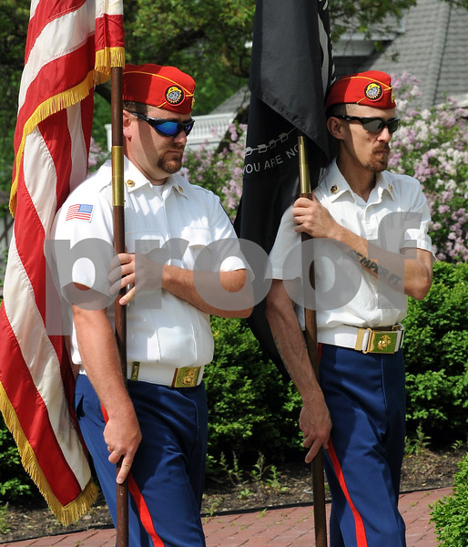 Commandant Brent Bacon (left) and Senior Vice Commandant Brad Davidson of the DeKalb County Marine Corps League, present the colors at the DeKalb Memorial Day program on Monday at The Ellwood HouseMuseum.  Steve Bittinger - For Shaw Media