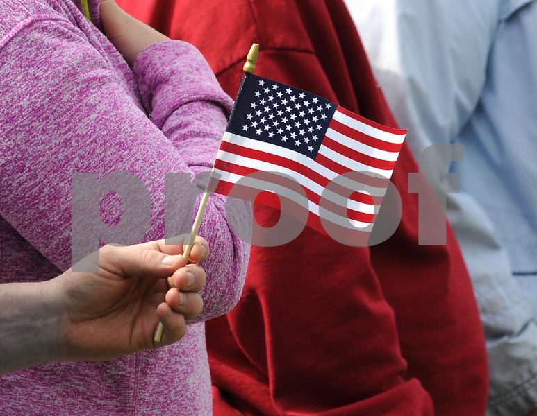 An American Flag is waved at the DeKalb Memorial Day festivities on Monday.  Steve Bittinger - For Shaw Media