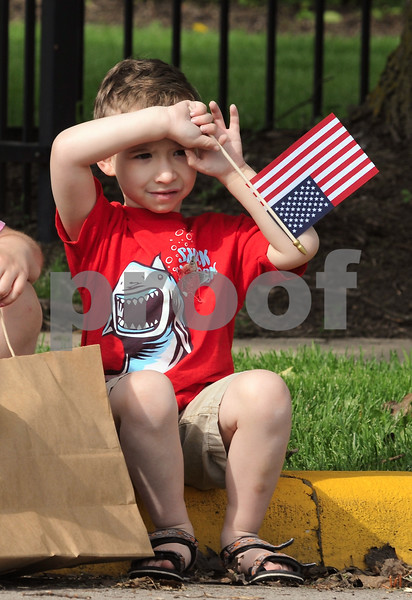 Four year old Griffin Nelson of DeKalb watches the Memorial Day parade on Monday.  Steve Bittinger - For Shaw Media