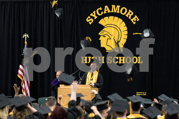Sam Buckner for Shaw Media.<br /> Caps are thrown in the air on Sunday May 28, 2017 in the Sycamore High School field house at the end of the graduation ceramony.