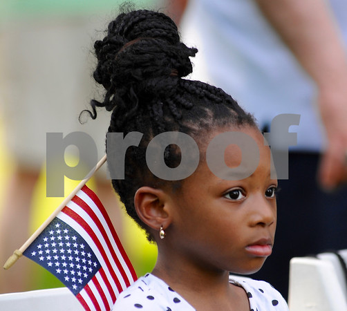 Four year old Matilda Nettey of Montgomery, listens to Memorial Day ceremonies at the Ellwood House Museum on Monday, May 28 in DeKalb.  <br /> Steve Bittinger - For Shaw Media