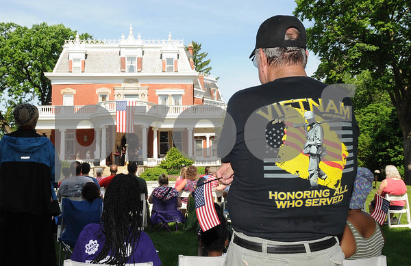 Veteran Tom Harris of Kingston attends the DeKalb Memorial Day program at the Ellwood House Museum on Monday, May 28.  Steve Bittinger - For Shaw Media