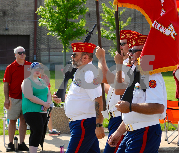 Members of the Marine Corps League march in the Memorial Day parade on Monday, May 28 in DeKalb.<br /> Steve Bittinger - For Shaw Media