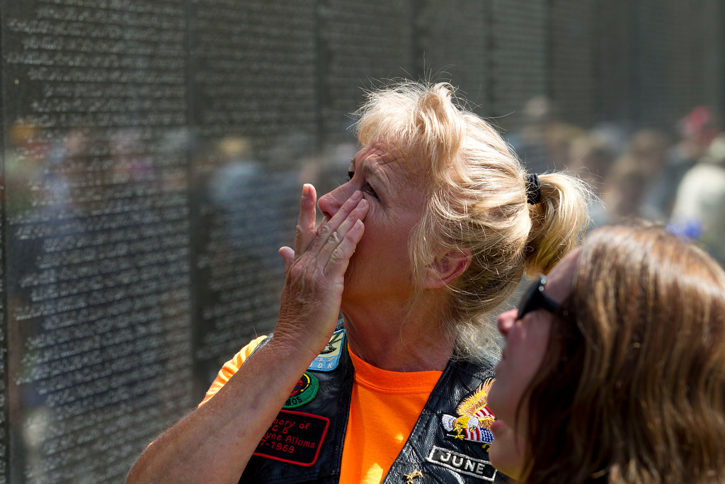 . June Allums Flowers looks at the name of her brother Allen W. Allums at Vietnam Veterans Memorial wall ahead of Memorial Day on Sunday, May 27, 2018, in Washington. (AP Photo/Jose Luis Magana)