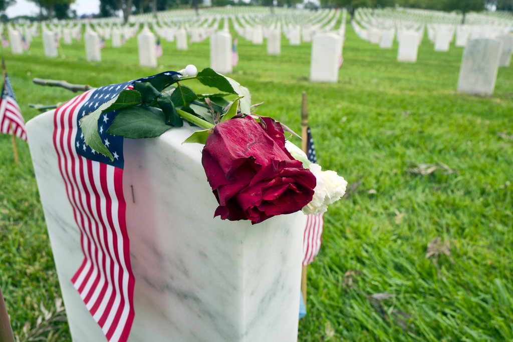 . A rose and an American flag rest on top of a veterans gravestone to honor fallen soldiers at the Los Angeles National Cemetery in celebration of Memorial Day in Los Angeles on Monday, May 28, 2018. (AP Photo/Richard Vogel)