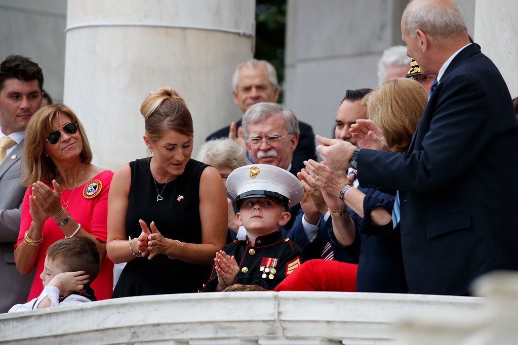 . Audience members applaud Christian Jacobs, center, who lost his father Marine Sgt. Christopher Jacobs, during a Memorial Day ceremony with President Donald Trump at Arlington National Cemetery, Monday, May 28, 2018, in Arlington, Va. (AP Photo/Evan Vucci)