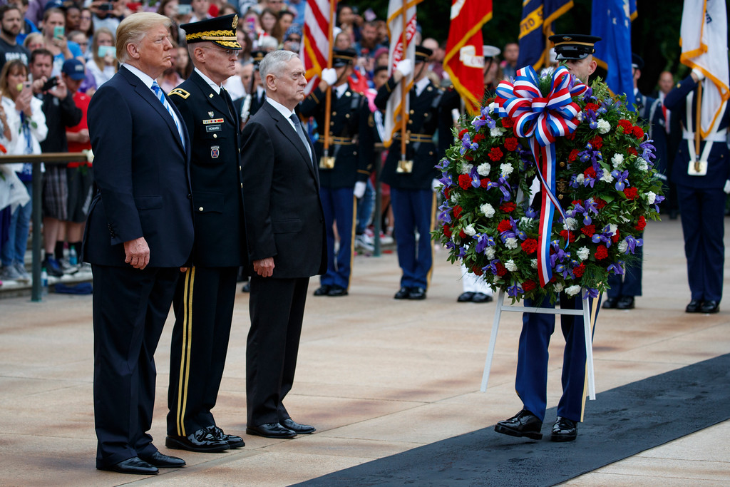 . President Donald Trump, left, Maj. Gen. Michael L. Howard, commanding general of Joint Force Headquarters-National Capital Region and the Military District of Washington, center, and Secretary of Defense Jim Mattis participate in a Memorial Day wreath laying ceremony at Arlington National Cemetery, Monday, May 28, 2018, in Arlington, Va. (AP Photo/Evan Vucci)