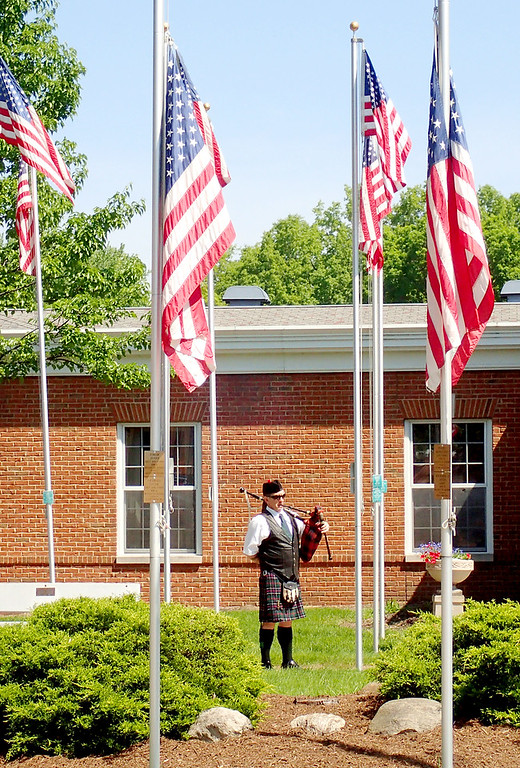 . Jonathan Tressler - The News-Herald. Wickliffe resident Shaun Gough plays amazing Grace on his bagpipes May 28 during Eastlake�s 2018 Memorial Day service at the Boulevard of 500 Flags.