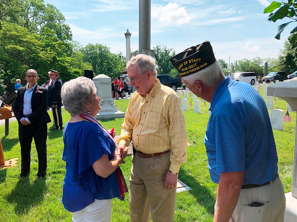 . Senate Majority Leader Mitch McConnell meets with people who attended a Memorial Day service in Louisville, Ky., Monday, May 28, 2018. McConnell was the featured speaker. (AP Photo/Bruce Schreiner)