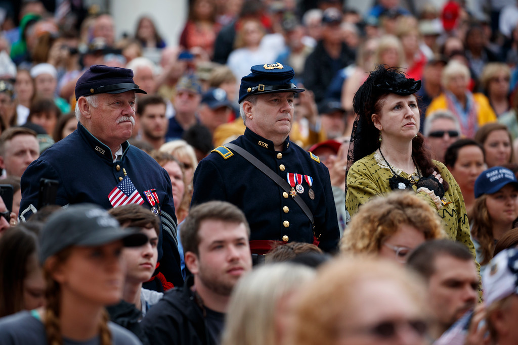 . Audience members dress in Civil War era clothing listen as President Donald Trump speaks during a Memorial Day ceremony at Arlington National Cemetery, Monday, May 28, 2018, in Arlington, Va. (AP Photo/Evan Vucci)