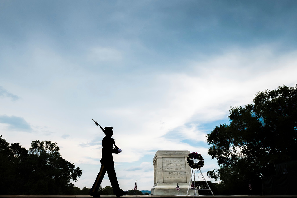 . A member of the U.S. Army 3rd Infantry Regiment walks his post in front of The Tomb of the Unknown Soldier in Arlington National Cemetery during the Memorial Day weekend in Arlington, Va., Sunday, May 27, 2018. (AP Photo/J. David Ake)