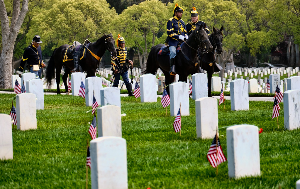 . The New Buffalo Soldiers arrive for a Memorial Day service at the Los Angeles National Cemetery in Los Angeles on Monday, May 28, 2018. (AP Photo/Richard Vogel)