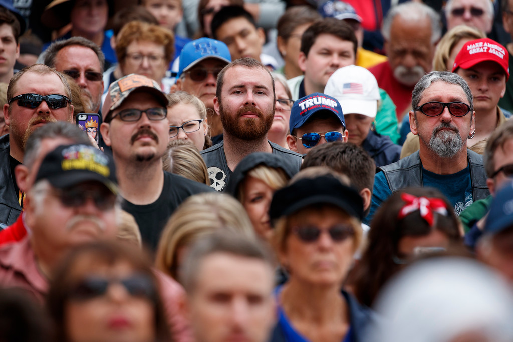 . Audience members listen as President Donald Trump speaks during a Memorial Day ceremony at Arlington National Cemetery, Monday, May 28, 2018, in Arlington, Va. (AP Photo/Evan Vucci)