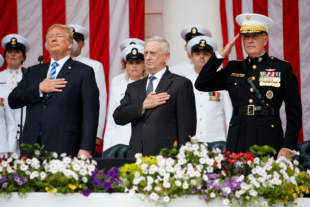 ". President Donald Trump, Secretary of Defense Jim Mattis, and Chairman of the Joint Chiefs of Staff Gen. Joseph Dunford, stand for ""Taps\"" during a Memorial Day ceremony at Arlington National Cemetery, Monday, May 28, 2018, in Arlington, Va. (AP Photo/Evan Vucci)"