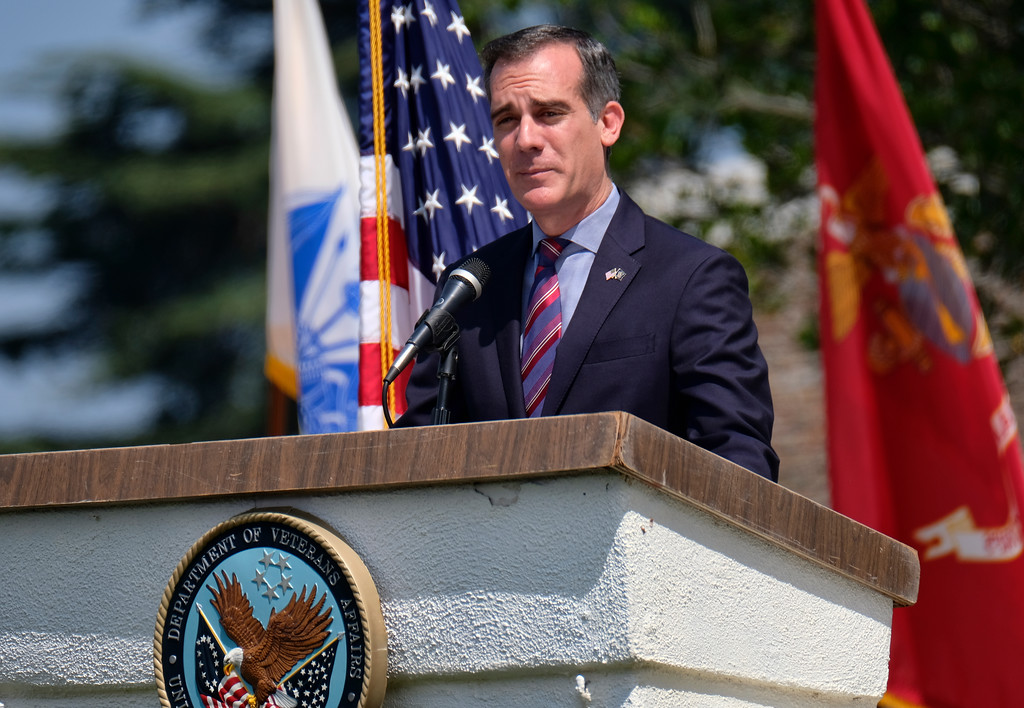 . Los Angeles Mayor Eric Garcetti speaks during an observance at the Los Angeles National Cemetery in Los Angeles on Monday, May 28, 2018. Californians are paying their respects on Memorial Day to those who have died serving their country. (AP Photo/Richard Vogel)