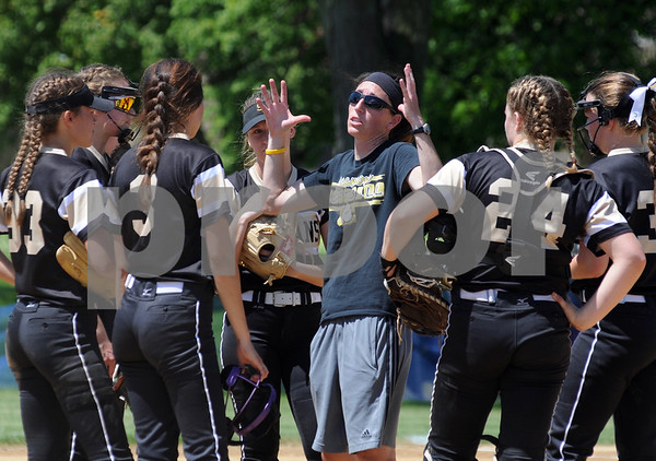 Sycamore coach Jill Carpenter talks to her players at the mound during regional championship action at Rosary in Aurora on Saturday, May 26.  Steve Bittinger - For Shaw Media