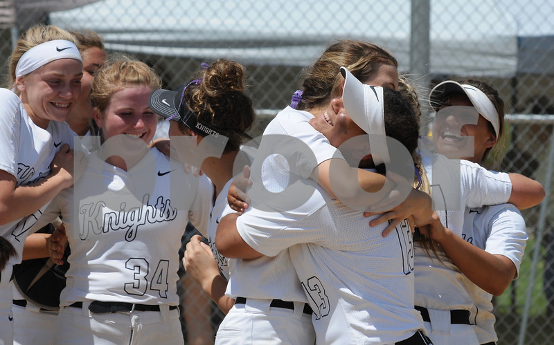 The Kaneland High School softball team celebrate winning the regional championship game at Rosary in Aurora on Saturday, May 26.  Steve Bittinger - For Shaw Media