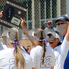 Hannah Theobald (right) raises the regional championship trophy with her Kaneland teammates on Saturday, May 26 in Aurora.  Steve Bittinger - For Shaw Media