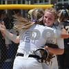 Kaneland catcher Lillie Lindgren (21) gives pitcher Emilee Erickson a big hug after defeating Sycamore for the regional championship on Saturday, May 26 in Aurora.  Steve Bittinger - For Shaw Media