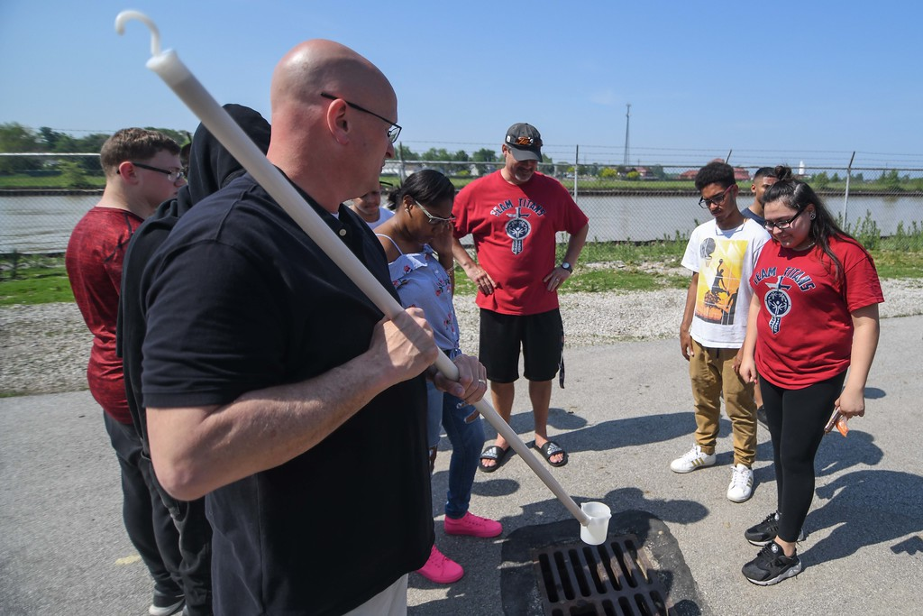 . Eric Bonzar�The Morning Journal<br> Tim Cox, assistant superintendent of the Black River Wastewater Treatment Plant, shows Lorain High School scholars a sample of the finished product, once the treated water is ready to be sent out into Lake Erie.
