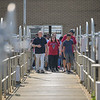 Eric Bonzar—The Morning Journal<br> Assistant Superintendent Tim Cox, left, walks a group of Lorain High School environmental science scholars through a tour of the city's Black River Waste Water Treatment Plant, May 29, 2018.