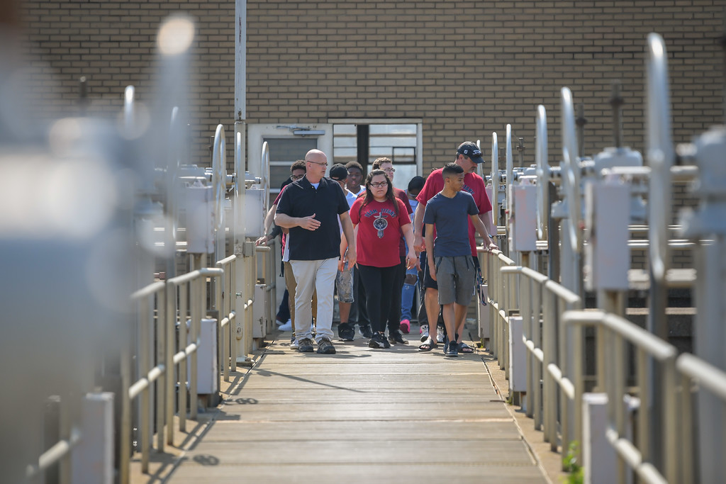 . Eric Bonzar�The Morning Journal<br> Assistant Superintendent Tim Cox, left, walks a group of Lorain High School environmental science scholars through a tour of the city\'s Black River Waste Water Treatment Plant, May 29, 2018.