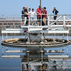 Eric Bonzar—The Morning Journal<br> Teacher John Akosi and a group of Lorain High School environmental science scholars get a tour of the city's waste water treatment plant, from plant assistant superintendent Tim Cox, May 29, 2018.