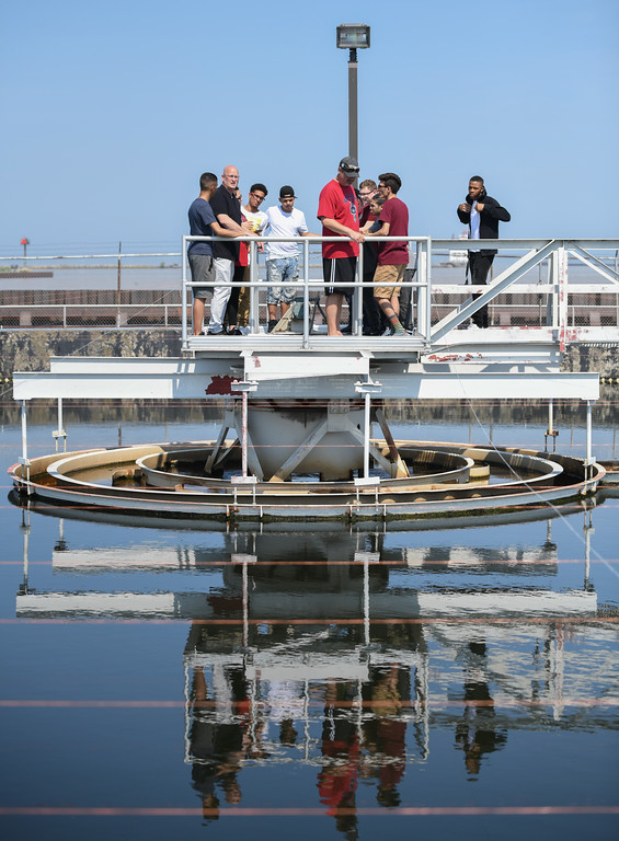 . Eric Bonzar�The Morning Journal<br> Teacher John Akosi and a group of Lorain High School environmental science scholars get a tour of the city\'s waste water treatment plant, from plant assistant superintendent Tim Cox, May 29, 2018.