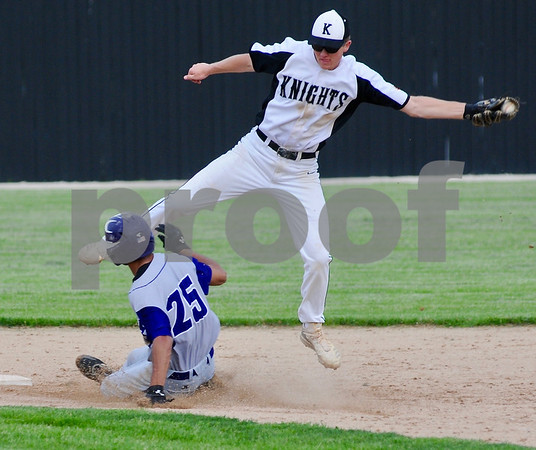 Bryce Stair of Kaneland goes high for a throw as Talbir Chima of Dixon steals second on Wednesday in Sycamore.  Steve Bittinger - For Shaw Media