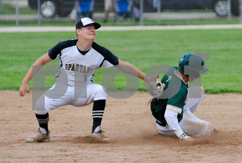 Logan Riley of Sycamore puts the tag on a Boylan baserunner during sectional action on Wednesday.  Steve Bittinger - For Shaw Media