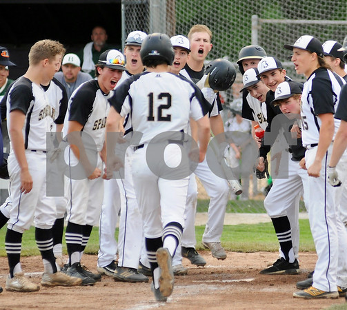 Spartan Gage Armstrong of Sycamore is greeted at home plate after a home run in sectional play on Wednesday.  Steve Bittinger - For Shaw Media
