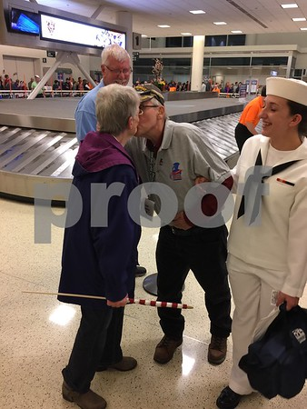 Leslie Larson, 83, of Shabbona, is greeted by his wife, Dolores, at Midway Airport after traveling to Washington, D.C., to view the Korean War Veterans Memorial on an Honor Flight.