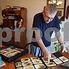 Leslie Larson, 83, of Shabbona looks through a photo album of pictures from his time as a soldier during the Korean War, from 1952 to 1954. Larson traveled to Washington, D.C., on May 10 to view the Korean War Veterans Memorial on an Honor Flight.