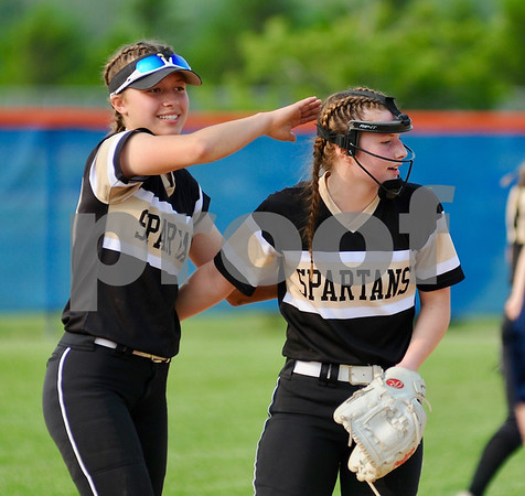 Spartan Haley Trela gives teammate Erin Simmons a pat on the head after a play during a sectional final win for Sycamore on Friday.  Steve Bittinger - For Shaw Media