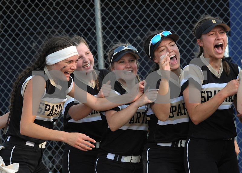 Sycamore softball players celebrate a sectional final win over Sterling on Friday at Genoa-Kingston High School.  Steve Bittinger - For Shaw Media